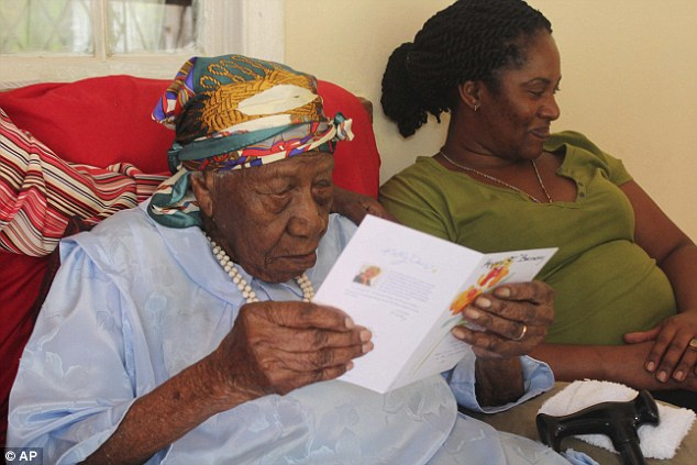 * Violet reads a card on April 16 at hre home in Duanevale, Jamaica Read more: http://www.dailymail.co.uk/news/article-4419798/Jamaican-woman-former-slave-new-oldest-person.html#ixzz4eaLVj4nL Follow us: @MailOnline on Twitter | DailyMail on Facebook